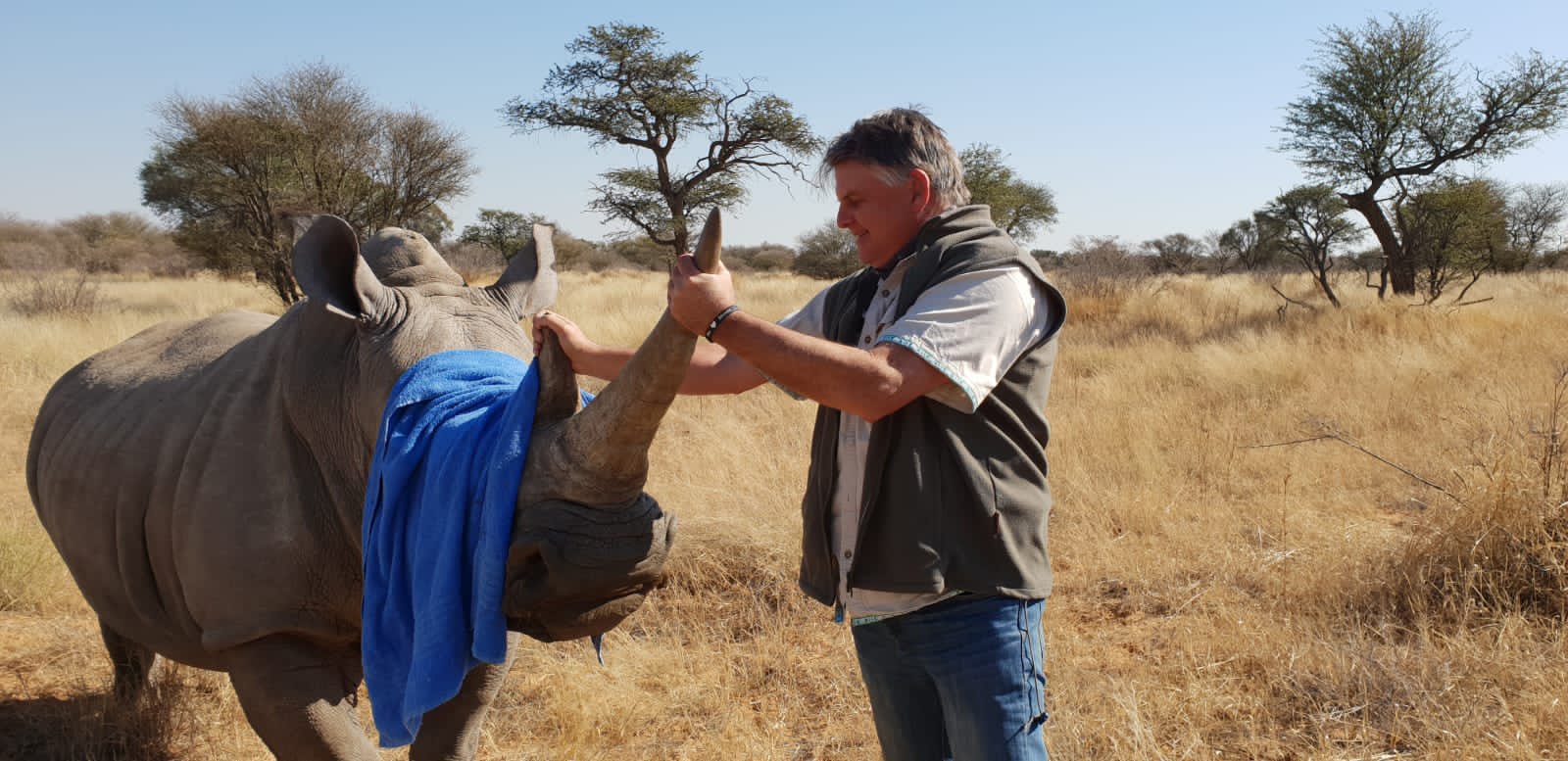 Grant Fowlds with a rhino